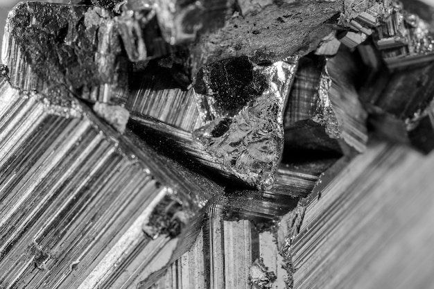 Detail of a pyrite mineral in black and white. pyrite is a very common mineral composed of iron disulfide which produces sparks when struck with a piece of metal.