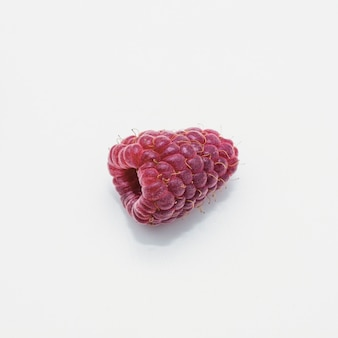 Detail of raspberry isolated on white background