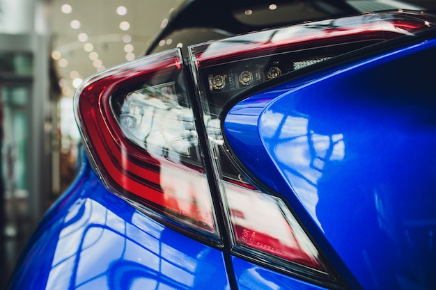 Detail on rear light blue car