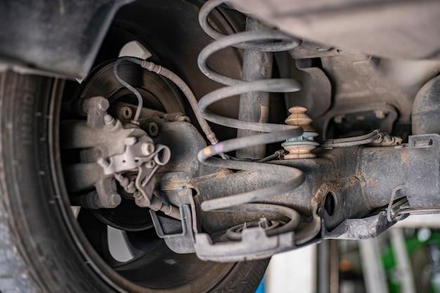 Detail of rigid axle car shock absorbers