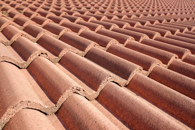 Detail of a roof built with red terracotta tiles