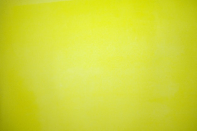 Detail of rough textured grooved designer paper surface full frame background in bright yellow color copy space. horizontal orientation.