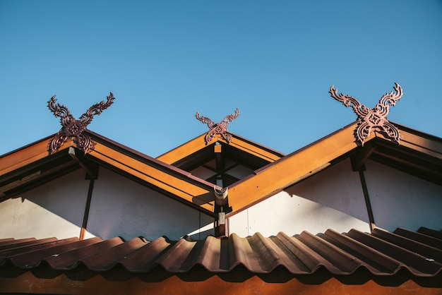 Detail of rural thai hip roof house in the akha village of maejantai on the hill in chiang mai, thailand.
