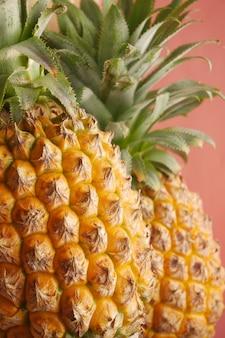 Detail shot of fresh pineapple in bowl on table