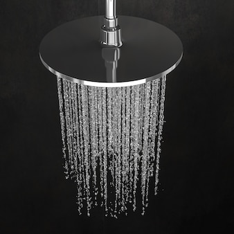 Detail of a shower head with modern dark tiles.