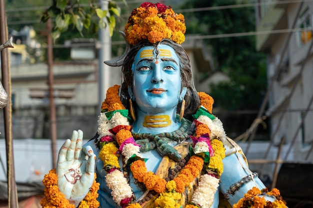 Detail of the statue of shiva, hindu idol on the ghat near the ganges river in rishikesh, india, close up