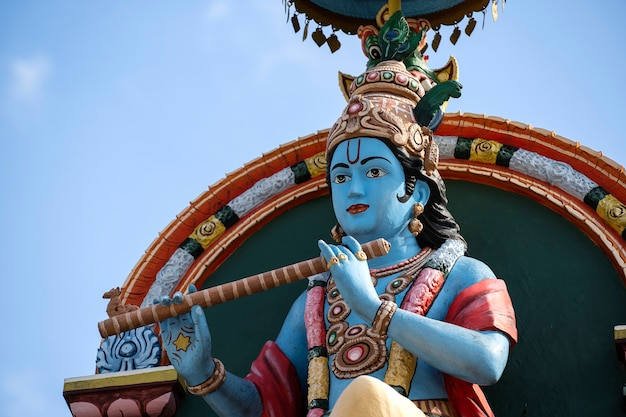 Detail stone statue in sri krishnan temple on south indian hindu temple in singapore on blue sky background