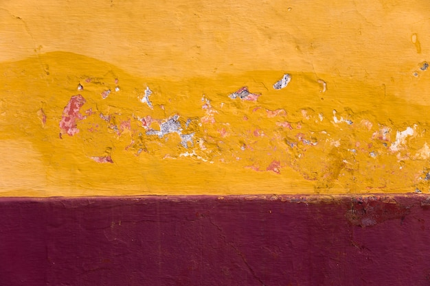 Detail of traditional red and yellow facade from madeira island, portugal
