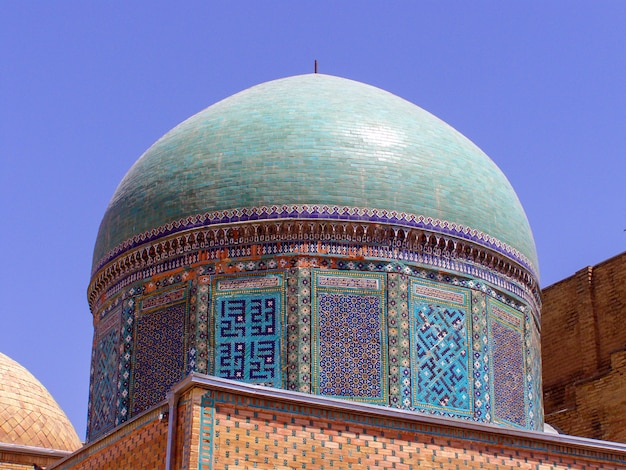 Detail of two blue turquoise domes in the shah-zinda memorial complex, samarkand, uzbekistan.