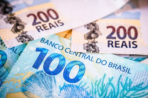 The detail of the two hundred and one hundred reais notes the real is the currency of brazil