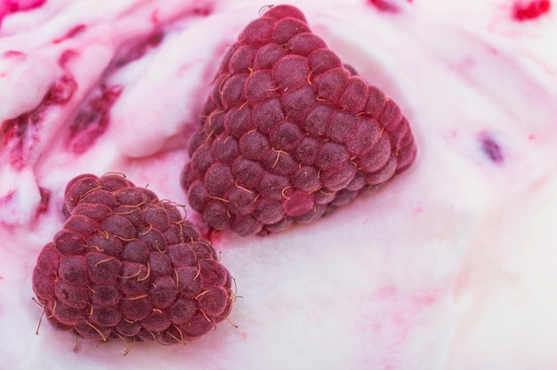 Detail of two raspberry on ice cream