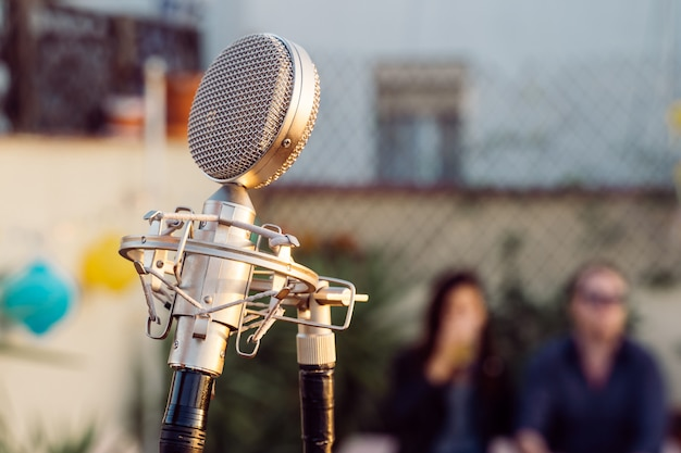 Detail of a vintage old microphone isolated on a festival. live music concept. intimate concert abut to start. music outdoors concept.