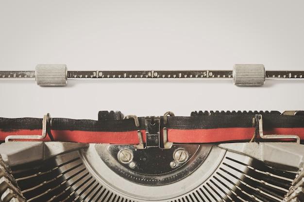 Detail of vintage typewriter whit sheet of  white paper