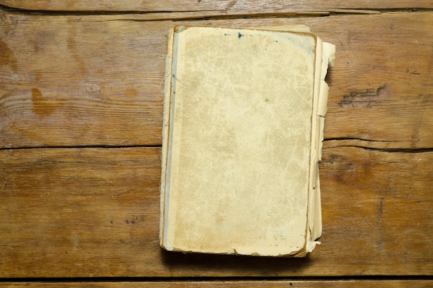 Detailed antique book with blank cover on the vintage wooden table top