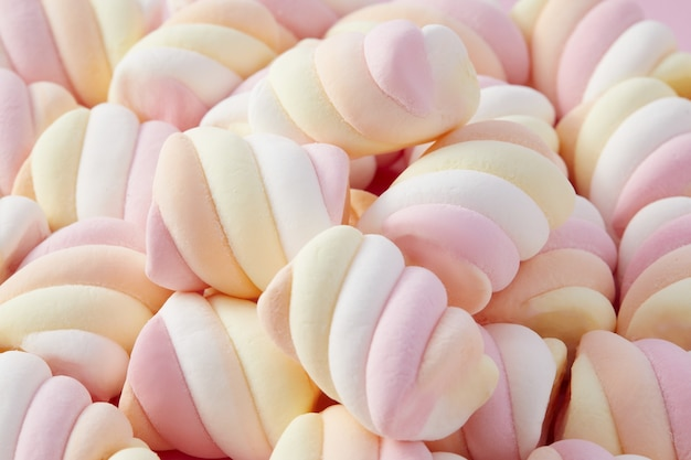 Detailed closeup of colorful white, pink and yellow marshmallows