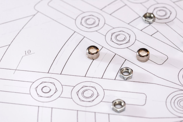 Detailed drawing of parts, nuts on paper