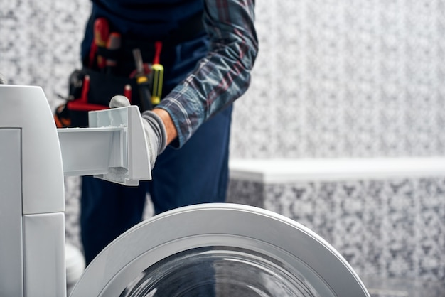 Detailed inspection working man plumber in bathroom checking