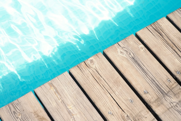 Detailed view of a wooden floor and pool