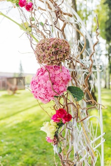 Details of beautiful floral arch for wedding ceremony.