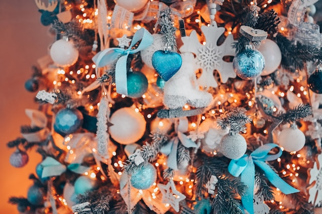Details of a christmas decorated tree in soft pink and turquoise colors