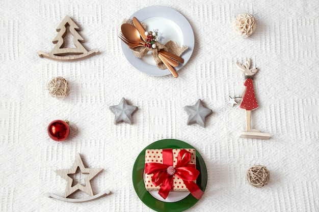 Details for christmas table setting on white background close up.