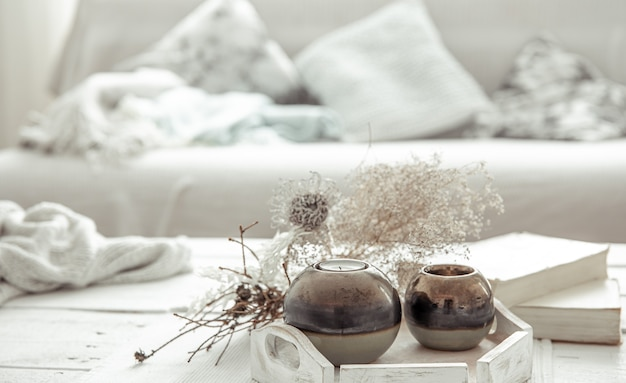 Details of the decor on the table in the living room in a hygge style