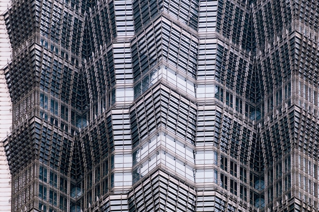 Details of the facade of a modern skyscraper made of glass and steel closeup.