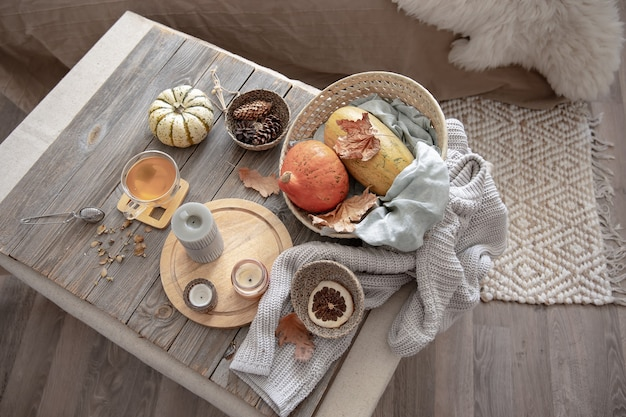 Details of home autumn decor in rustic style in the interior of the room, top view.