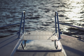 Details of the yacht, deck, reflection of the sky.