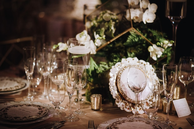 Details of set the table with focus on glasses