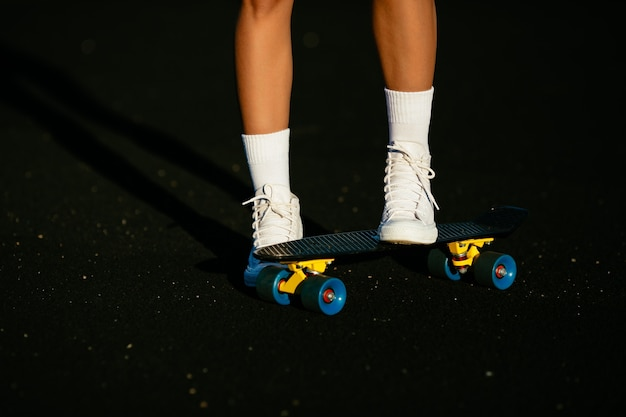 Details. skateboard, white shoes.