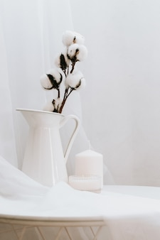 Details of still life in the home interior of living room on white . candle, vase. moody. copy space for text