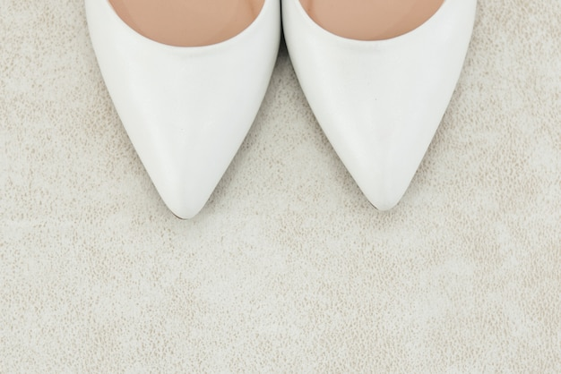 The details of the wedding day. bride's shoes on a light background