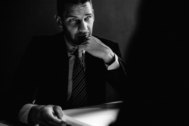 Detective interview suspect  in interrogation room