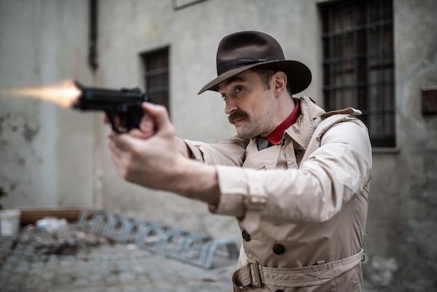 Detective shooting his gun in a skid row