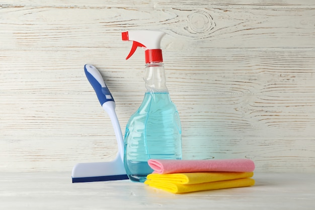 Detergent liquid and cleaning supplies on wooden