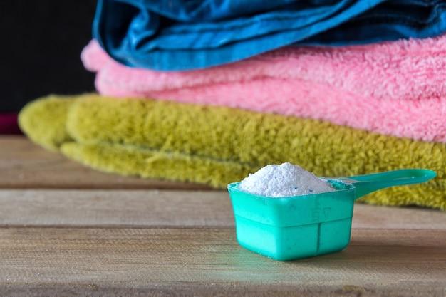 Detergent or washing powder in measuring spoon