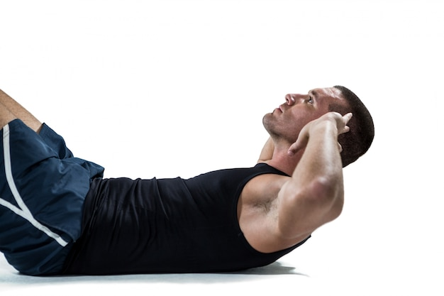 Determined athlete doing crunches