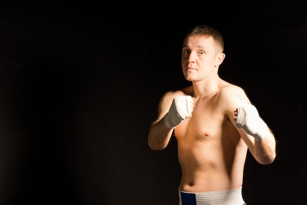 Determined intense young boxer