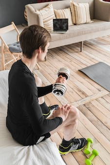 Determined male exercising with dumbbell