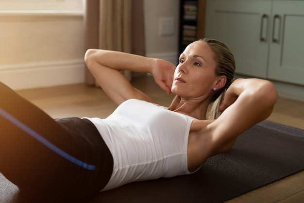 Determined mature woman doing exercise