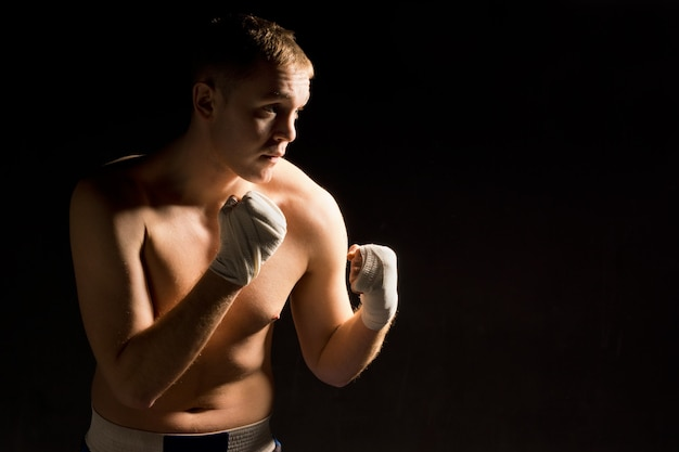Determined pugnacious young boxer in the ring