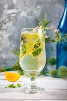 Detox cold lemonade with lime, mint and lemon zest, diet drink, healthy summer cocktail