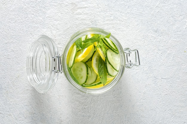 Detox drink cucumber water in the glass top view. diet concept