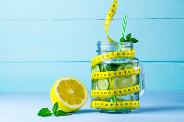 Detox drink juicy lemon, mint and measuring tape