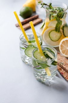 Detox drinking water and protein bar, snack after exercise, diet food