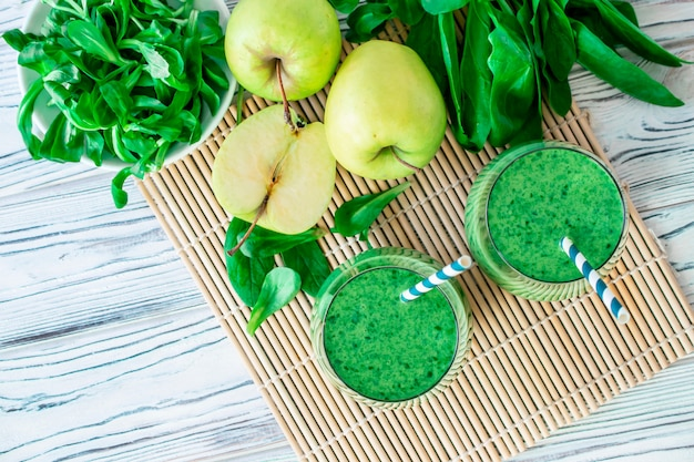 Detox fresh green smoothie with spinach, apple, mache lamb lettuce, flat lay