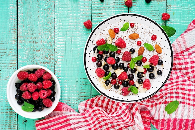 Detox and healthy superfoods breakfast in bowl. vegan almond milk chia seeds pudding