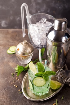 Detox infused cucumber water. refreshing summer homemade cocktail on stone background