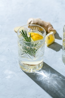 Detox infused water with lemon, ginger and rosemary